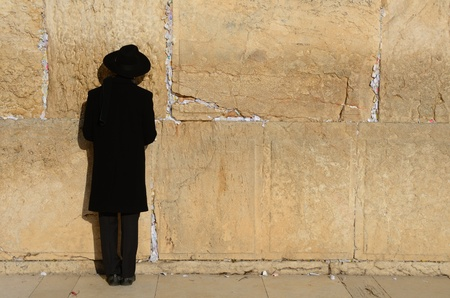 hasidic: JERUSALEM - FEBRUARY 19: A hassidic Jew prays at the wailing wall in the Old City February 19, 2012 in Jerusalem, Israel. The wall is the holiest site in Judasim.
