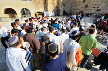 worshipers: JERUSALEM - FEBRUARY 20: Jews pray at the Kotel February 20, 2012 in Jerusalem, IL. The kotel is one of the holiest sites in Judaism attracting thousands of worshipers daily. Editorial