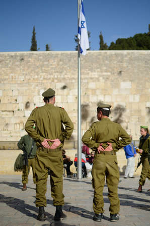 exceptions: JERUSALEM - FEBRUARY 23: Soldiers at the Western Wall February 23, 2012 in Jerusalem, IL. military service is mandatory for all Israeli citizens over the age of 18 with several exceptions. Editorial