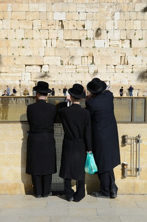 worshipers: JERUSALEM - FEBRUARY 20: Hasidic Jews at the Kotel (Western Wall) February 20, 2012 in Jerusalem, IL. The kotel is one of the holiest sites in Judaism attracting thousands of worshipers daily.