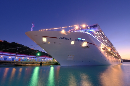 ST. THOMAS - JANUARY 3: The Carnival Dream at Port January 3, 2012 in ST. Thomas, U.S. Virgin Islands. The Dream is the biggest ship built for Carnival at 130,000 tons. Stock Photo - 12533473
