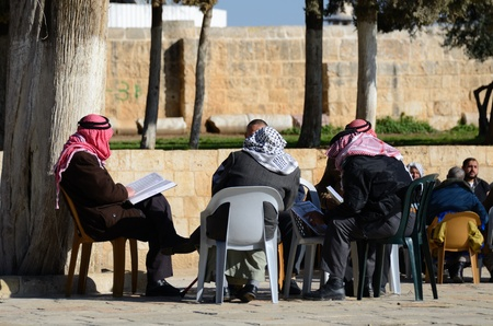 JERUSALEM - FEBERUARY 20: Islamic men discuss the Koran on the Temple Mount February 20, 2012 in Jerusalem Israel. Among Sunnis, the site is the 3rd holiest in Islam.