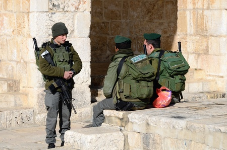 JERUSALEM - FEBRUARY 20: Israeli Border Police chat February 20, 212 in Jerusalem, IL. Known as Magav in Hebrew, their main task is securing Israels borders.