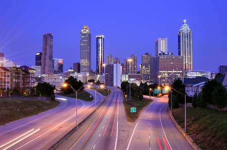 parkway: Skyline of Downtown Atlanta, Georgia above Freedom Parkway at twilight.