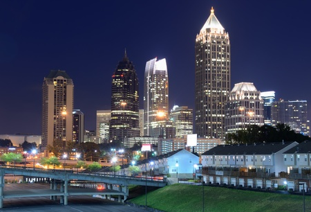 atl: Skyline of Downtown Atlanta, Georgia above Freedom Parkway at twilight.