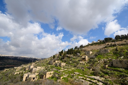 high rises: Lifta, a Jerusalem village which was abandoned by the Palestinians during the Israeli War of Independence, juxtaposed against new Israeli high rises