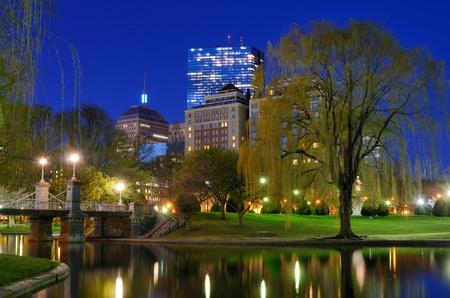 Lagoon Bridge and skyline of Boston, Massachusetts fromthe Boston Public Gardens.  photo