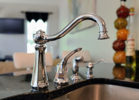stainless steet sink faucet Stock Photo