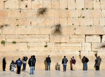 JERUSALEM - FEBRUARY 19: Members of the Jewish faith pray at the western wall February 19, 2012 in Jerusalem, IL. The wall is one of the holiest sites in Judaism attracting thousands of worshipers daily.
