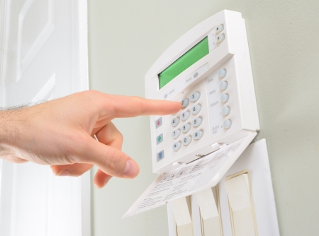 home security system: pressing the code on a house alarm Stock Photo