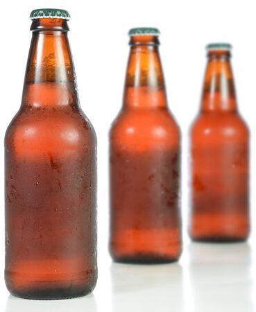 brown bottle: Three full beer bottles isolated on white.