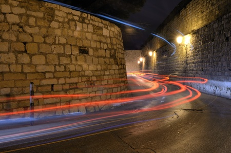 Light trails from  vehicles passing through narrow corridors in the Old City of Jerusalem, Israel. photo