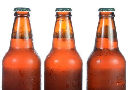 ipa: Three full beer bottles isolated on white.