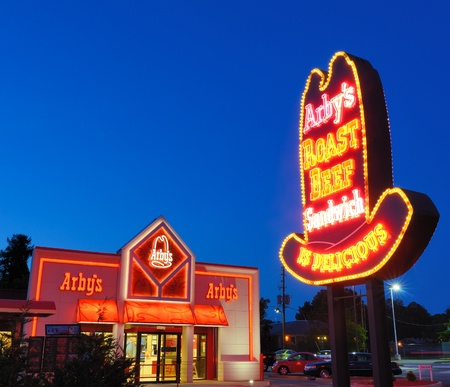 restuarant: Athens, Georgia, USA - May 5, 2012: A classic Arbys cowboy hat sign at an Arbys restuarant. With over 3,600 locations globally, the fast-food chain has been replacing their signs with lighter and more modern designs.