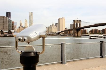 binoculars view: binoculars for sightseeing from Brooklyn towards Lower Manhattan in New York City Stock Photo
