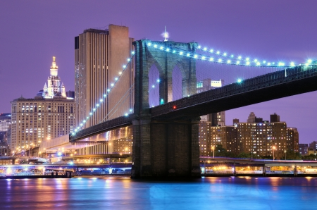 Brooklyn Bridge spans the East River towards Manhattan in New York City