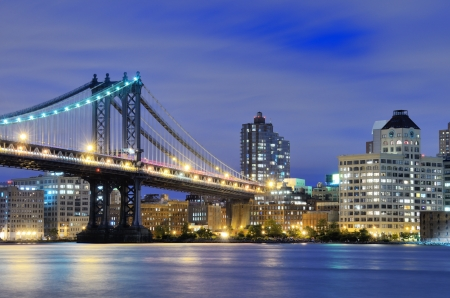 and scape: Manhattan Bridge spanning the East River towards Manhattan in New York City