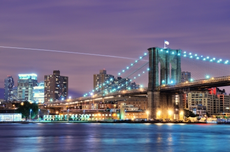 usa cityscape: Brooklyn Bridge spanning the East River towards Brooklyn in New York City  Stock Photo