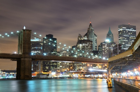 river scape: Brooklyn Bridge spanning the East River towards Manhattan in New York City