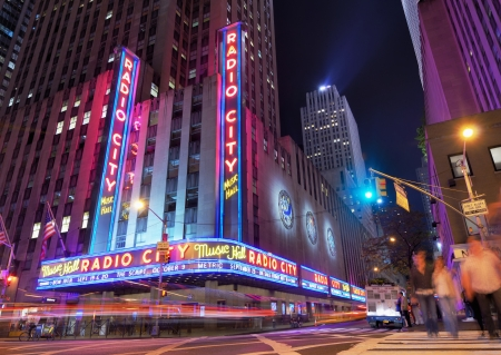 city center: New York City, USA - May 12, 2012: Radio City Music Hall at Rockefeller Center as seen from Avenue of the Americas. Completed in 1932, the famous music hall was declared a city landmark in 1978.