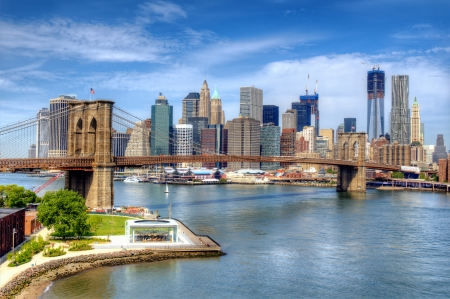 Brooklyn Bridge spans the East River towards Lower Manhattan in New York City. Editorial