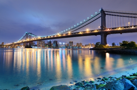 city scape: Manhattan Bridge spanning the East River towards Manhattan in New York City. Stock Photo