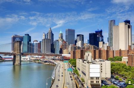 Brooklyn Bridge spans the East River towards Lower Manhattan in New York City. photo