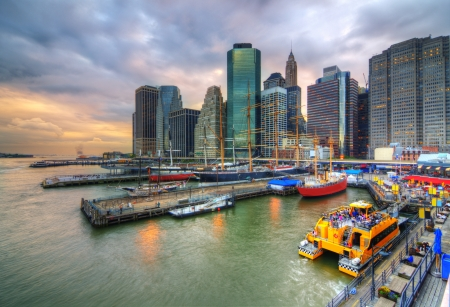 The historic district of South Street Seaport juxtaposed against the imposing Financial District skyscrapers  photo