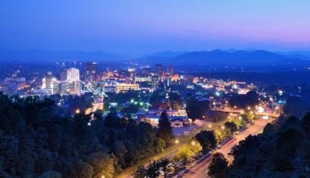 nestled: Asheville, North Carolina skyline nestled in the Blue Ridge Mountains. Stock Photo