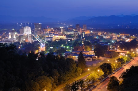 nestled: Asheville, North Carolina skyline nestled in the Blue Ridge Mountains. Stock Photo