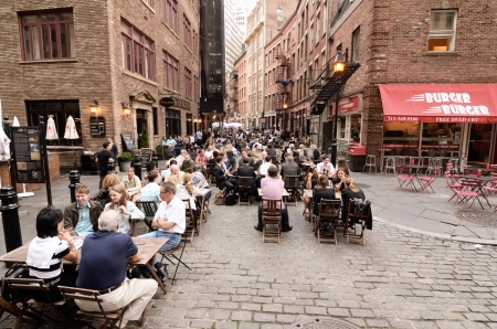 permits: NEW YORK CITY - MAY 16: Stone Street May 16, 2012 in New York, NY. The historic street dates from 1660 and currently features outdoor dining when weather permits.