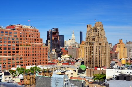 Urban scene of high rises in Lower Manhattan viewed from a Chelsea rooftop Banco de Imagens