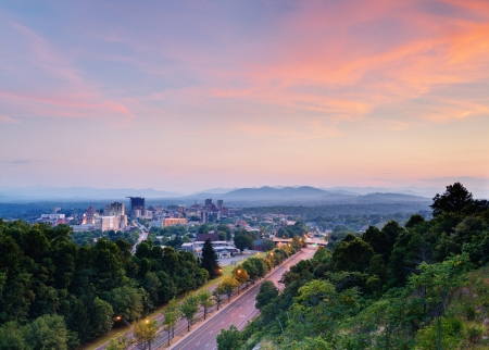 nestled: Asheville, North Carolina skyline nestled in the Blue Ridge Mountains