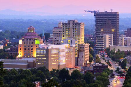 asheville: Asheville, North Carolina skyline nestled in the Blue Ridge Mountains