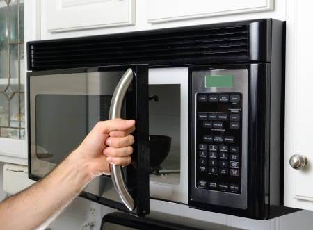 microwave: opeing a microwave door Stock Photo