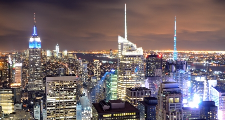 Famed New New York City skyscrapers in midtown Manhattan at night  photo