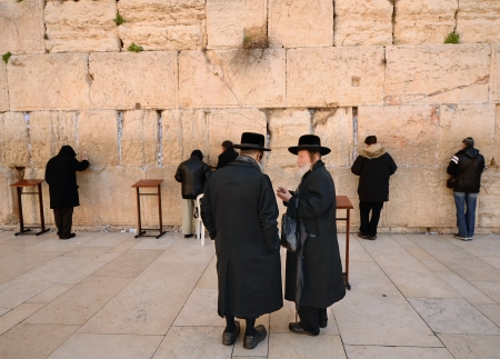 israelis: JERUSALEM - FEBRUARY 22: Worshipers at the Western Wall February 22, 2012 in Jerusalem, IL. The site is the holiest in Judaism with the exception of the Temple Mount itself.