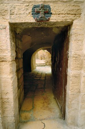 Doorway in Jerusalem, Israel with a symbol of a cross Stock Photo - 14681184