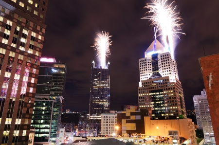 Fireworks launch from skyscrapers in downtown PIttsburgh, Pennsylvania, USA Stock Photo - 14842450