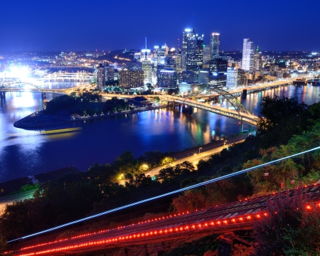 Incline operating in front of the downtown skyline of Pittsburgh, Pennsylvania, USA. photo