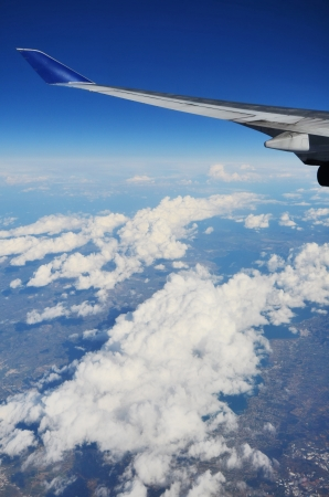 wing of a plane and terrestrial landscape