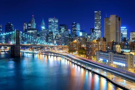 new buildings: View of the financial district of Manhattan at night in New York City. Stock Photo