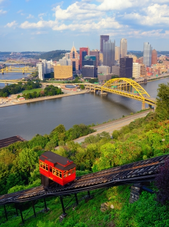 Incline operating in front of the downtown skyline of Pittsburgh, Pennsylvania, USA