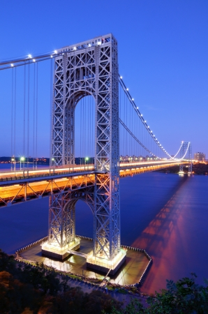 The George Washington Bridge spans the Hudson River from Fort Lee, New Jersey to the Washington Heights neighborhood in the borough of Manhattan in the city of New York, New York  photo