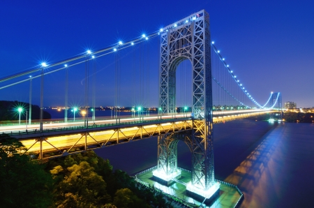 The George Washington Bridge spans the Hudson River from Fort Lee, New Jersey to the Washington Heights neighborhood in the borough of Manhattan in the city of New York, New York