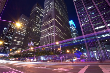 night traffic: Office buildings at night along 6th Avenue in New York City
