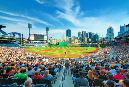 backs: Pittsburgh, Pennsylvania - August 14, 2012: Pirates play the Arizona Diamond Backs at PNC Stadium with the central business district in the the background.