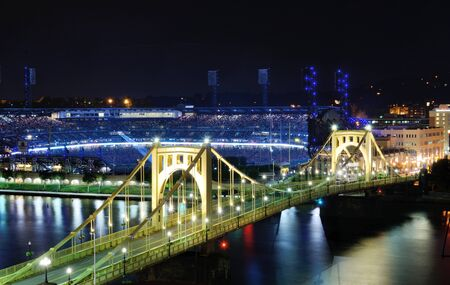 PITTSBURGH - AUGUST 11: Roberto Clemente Bridge and PNC Park August 11, 2012 in Pittsburgh, PA. PNC Park is the fifth home to the Pittsburgh Pirates and hosts a variety of concerts and events.
