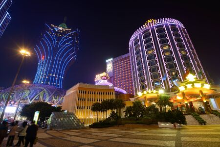 annually: MACAU - OCTOBER 12: Skyline of Macau at Nam Van Lake. The city maintains the worlds highest gambling revenue and attracts over 20 million tourists annually.