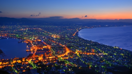 The dawn sky over the reknown view of Hakodate, Japan. The city was the first in Japan to open its ports to trade in 1854. photo